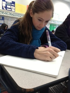 Kaitlyn Kelly taking notes in class.